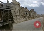 Image of Allied troops advancing through ruins and beach obstacles Valognes France, 1944, second 21 stock footage video 65675020907