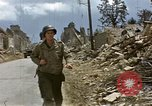 Image of Allied troops advancing through ruins and beach obstacles Valognes France, 1944, second 22 stock footage video 65675020907
