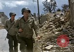 Image of Allied troops advancing through ruins and beach obstacles Valognes France, 1944, second 23 stock footage video 65675020907