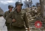 Image of Allied troops advancing through ruins and beach obstacles Valognes France, 1944, second 24 stock footage video 65675020907