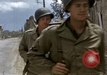 Image of Allied troops advancing through ruins and beach obstacles Valognes France, 1944, second 25 stock footage video 65675020907
