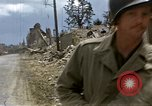 Image of Allied troops advancing through ruins and beach obstacles Valognes France, 1944, second 26 stock footage video 65675020907