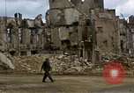 Image of Allied troops advancing through ruins and beach obstacles Valognes France, 1944, second 27 stock footage video 65675020907