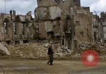 Image of Allied troops advancing through ruins and beach obstacles Valognes France, 1944, second 28 stock footage video 65675020907