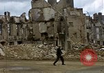 Image of Allied troops advancing through ruins and beach obstacles Valognes France, 1944, second 29 stock footage video 65675020907