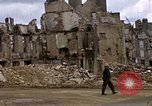 Image of Allied troops advancing through ruins and beach obstacles Valognes France, 1944, second 30 stock footage video 65675020907