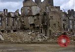 Image of Allied troops advancing through ruins and beach obstacles Valognes France, 1944, second 31 stock footage video 65675020907