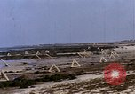 Image of Allied troops advancing through ruins and beach obstacles Valognes France, 1944, second 34 stock footage video 65675020907