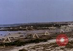 Image of Allied troops advancing through ruins and beach obstacles Valognes France, 1944, second 35 stock footage video 65675020907