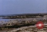 Image of Allied troops advancing through ruins and beach obstacles Valognes France, 1944, second 36 stock footage video 65675020907