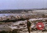 Image of Allied troops advancing through ruins and beach obstacles Valognes France, 1944, second 37 stock footage video 65675020907