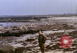 Image of Allied troops advancing through ruins and beach obstacles Valognes France, 1944, second 38 stock footage video 65675020907