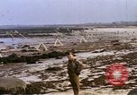Image of Allied troops advancing through ruins and beach obstacles Valognes France, 1944, second 39 stock footage video 65675020907