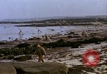 Image of Allied troops advancing through ruins and beach obstacles Valognes France, 1944, second 40 stock footage video 65675020907