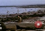 Image of Allied troops advancing through ruins and beach obstacles Valognes France, 1944, second 41 stock footage video 65675020907