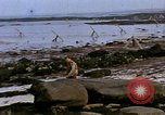 Image of Allied troops advancing through ruins and beach obstacles Valognes France, 1944, second 42 stock footage video 65675020907