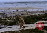 Image of Allied troops advancing through ruins and beach obstacles Valognes France, 1944, second 46 stock footage video 65675020907