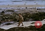 Image of Allied troops advancing through ruins and beach obstacles Valognes France, 1944, second 47 stock footage video 65675020907