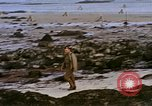 Image of Allied troops advancing through ruins and beach obstacles Valognes France, 1944, second 48 stock footage video 65675020907