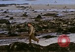 Image of Allied troops advancing through ruins and beach obstacles Valognes France, 1944, second 49 stock footage video 65675020907