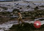 Image of Allied troops advancing through ruins and beach obstacles Valognes France, 1944, second 50 stock footage video 65675020907