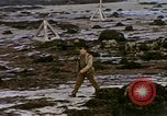 Image of Allied troops advancing through ruins and beach obstacles Valognes France, 1944, second 51 stock footage video 65675020907