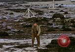 Image of Allied troops advancing through ruins and beach obstacles Valognes France, 1944, second 52 stock footage video 65675020907