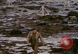 Image of Allied troops advancing through ruins and beach obstacles Valognes France, 1944, second 54 stock footage video 65675020907