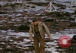 Image of Allied troops advancing through ruins and beach obstacles Valognes France, 1944, second 56 stock footage video 65675020907