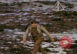 Image of Allied troops advancing through ruins and beach obstacles Valognes France, 1944, second 57 stock footage video 65675020907