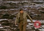 Image of Allied troops advancing through ruins and beach obstacles Valognes France, 1944, second 58 stock footage video 65675020907