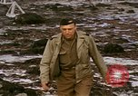 Image of Allied troops advancing through ruins and beach obstacles Valognes France, 1944, second 59 stock footage video 65675020907
