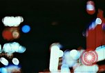 Image of Times Square neon lights in rain New York City USA, 1954, second 3 stock footage video 65675021110