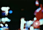 Image of Times Square neon lights in rain New York City USA, 1954, second 9 stock footage video 65675021110