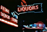 Image of Times Square neon lights in rain New York City USA, 1954, second 37 stock footage video 65675021110
