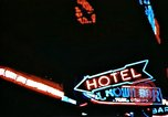 Image of Times Square neon lights in rain New York City USA, 1954, second 38 stock footage video 65675021110