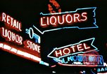 Image of Times Square neon lights in rain New York City USA, 1954, second 40 stock footage video 65675021110