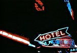 Image of Times Square neon lights in rain New York City USA, 1954, second 42 stock footage video 65675021110