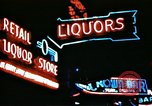 Image of Times Square neon lights in rain New York City USA, 1954, second 43 stock footage video 65675021110