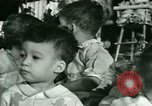 Image of Christmas party New York United States USA, 1947, second 26 stock footage video 65675021113