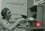 Image of Prisoner trains birds at US operated POW camp United States USA, 1944, second 12 stock footage video 65675021176