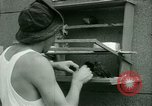 Image of Prisoner trains birds at US operated POW camp United States USA, 1944, second 15 stock footage video 65675021176