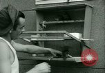 Image of Prisoner trains birds at US operated POW camp United States USA, 1944, second 22 stock footage video 65675021176