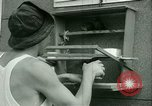 Image of Prisoner trains birds at US operated POW camp United States USA, 1944, second 23 stock footage video 65675021176
