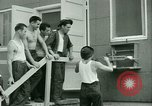 Image of Prisoner trains birds at US operated POW camp United States USA, 1944, second 30 stock footage video 65675021176