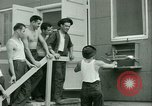 Image of Prisoner trains birds at US operated POW camp United States USA, 1944, second 31 stock footage video 65675021176