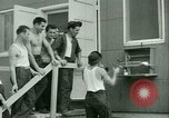 Image of Prisoner trains birds at US operated POW camp United States USA, 1944, second 32 stock footage video 65675021176