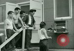 Image of Prisoner trains birds at US operated POW camp United States USA, 1944, second 35 stock footage video 65675021176