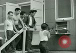 Image of Prisoner trains birds at US operated POW camp United States USA, 1944, second 36 stock footage video 65675021176