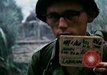 Image of U.S. Army 196th Lt Inf Brigade knock down damaged building wall Vietnam, 1968, second 3 stock footage video 65675021200